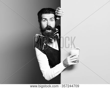 Handsome Bearded Man With Long Beard And Mustache Has Stylish Hair On Surprised Face Holding Glass O