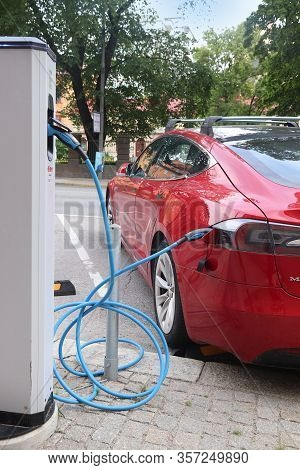 Stockholm, Sweden - August 24, 2018: Tesla Model S Electric Car Charging In Stockholm, Sweden. There