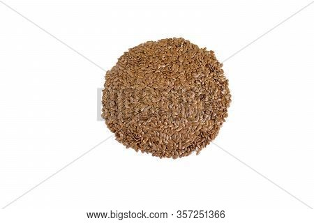 Flax Seed Heap Isolated On White Background. Linseeds. Flax Seeds Isolated On White Background. Top