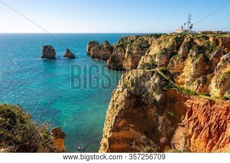 View Of Lagos Coastline In Portugal, Ponta Da Piedade In The Distance