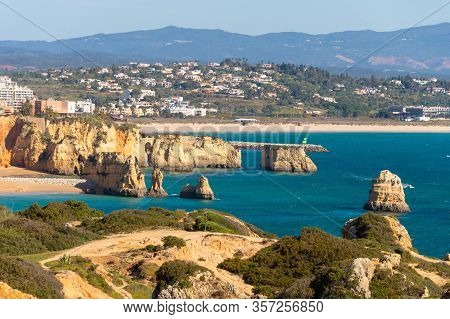 Lagos, Portugal - 7 March 2020: View Of Lagos Coastline In Portugal, Dona Ana Beach In The Distance