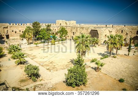 Kyrenia, Cyprus - September 27, 2017: Courtyard Of Medieval Fortress Castle With Palms Trees In Kyre