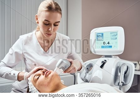 Ultraformer Lifting. Face Skin Care. Close-up Of Woman Getting Facial Hydro Microdermabrasion Peelin