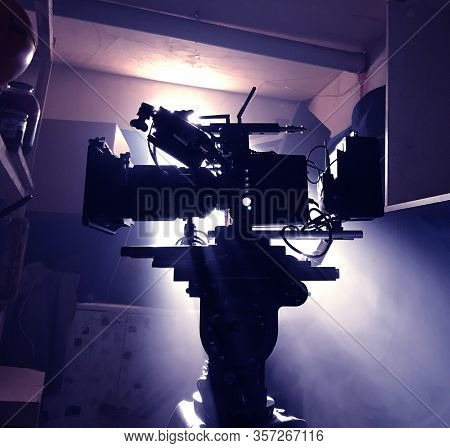 Mystical Silhouette Of A Movie Camera On A Tripod In Standby Mode