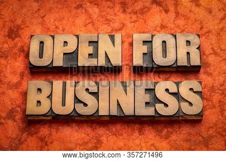 open for business word abstract in vintage letterpress wood type, business operation during coronavirus pandemic concept