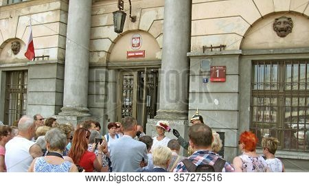 Lodz / Poland. 18 July 2019:  Crowd Of Elderly Tourists Listening To The Guide. Tourists In Polish C