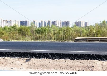 Layer Of Asphalt Road On The Background Of The City