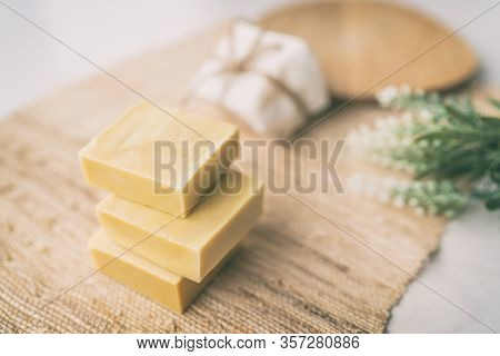DIY handmade soap natural homemade olive oil bars of soaps easy to do at home with lavender aromas from essential oils, on ramie texture background.
