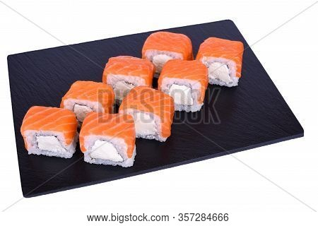 Traditional Fresh Japanese Sushi Rolls On A Black Stone Philadelphia Classic On A White Background.