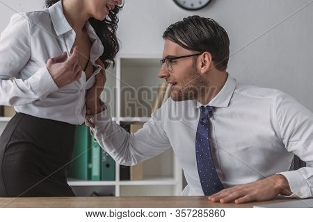 Excited Businessman Touching Breast Of Sexy Secretary In Office