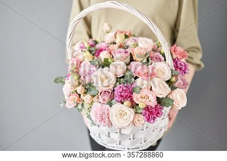 Small Flower Shop And Flowers Delivery. Flower Arrangement In Wicker Basket. Beautiful Bouquet Of Mi
