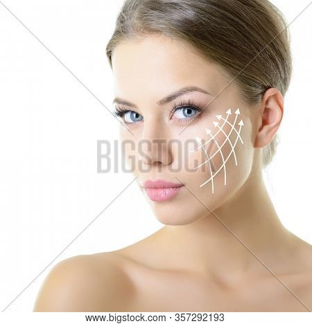 Beauty portrait of young woman with white lines on cheekbones for cosmetic medical procedures or plastic surgery. Skin care, anti-aging, lifting, rejuvenation concept