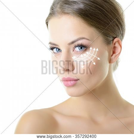 Beauty portrait of young woman with white lines around her eyes for cosmetic medical procedures or plastic surgery. Skin care, anti-aging, lifting, rejuvenation concept