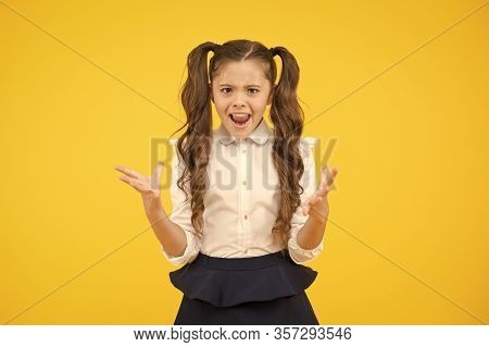 Failed Again. Furious Schoolgirl. Little Schoolgirl Gesturing Her Fists With Anger On Yellow Backgro