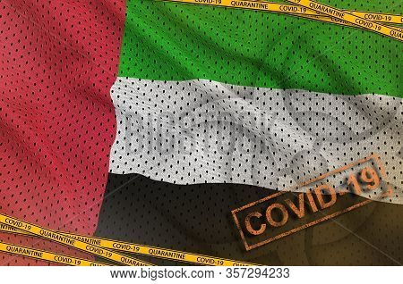 United Arab Emirates Flag And Covid-19 Biohazard Symbol With Quarantine Orange Tape And Stamp. Coron