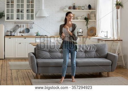 Happy Millennial Woman Dancing Relaxing Alone At Home