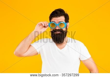 Keeping Eyes Protected In Fashion Sunglasses. Bearded Man Wear Glasses Yellow Background. Fashion Pa