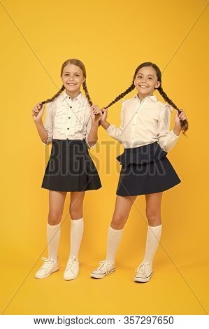 Natural Hair Extensions. Adorable Little Girls With Plaited Hair On Yellow Background. Cute Small Ch