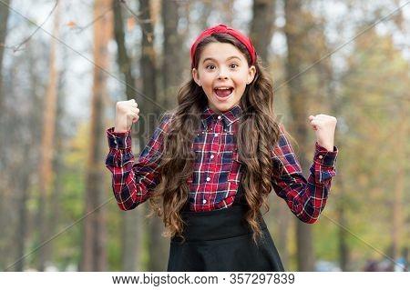 Winner Announced. Happy Winner Autumn Outdoors. Happy Girl Make Winner Gesture. Celebrating Victory