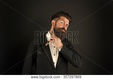 Good Beard Needs Good Barber. Bearded Man Hold Beard Grooming Tool. Businessman Shave Beard With Raz