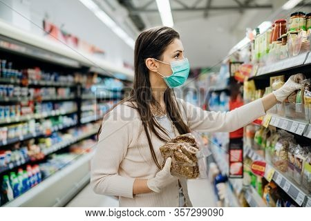 Shopping During An Epidemic.buyer Wearing A Protective Mask.nonperishable Smart Purchased Household