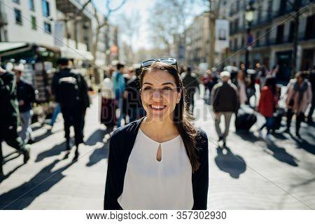 Cheerful Young Female Tourist Sightseeing In La Rambla Street,barcelona,spain.walking Down The Barce