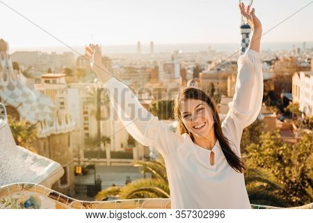 Cheerful Woman Tourist Visiting Parc Guell,famous Public Park In Barcelona,spain.sightseeing La Salu
