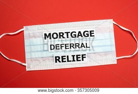 Mortgage Deferral Relief Writing On A Mask. Many Banks Worldwide Announced Mortgage And Payments Rel