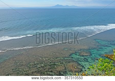 Beautiful Coastline With Volcanic Mountains At The Background. A Perfect Spot For Surfers All Over T