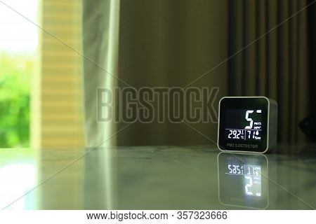 Air Quality Sensor Placing On A Table Indoor. Sensor Found Small Amount Of Air Pollution Of Pm 2.5 T