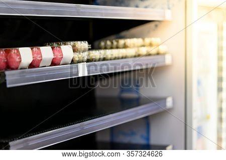 Empty Egg Shelves In A Grocery Store Or Supermarket. Hoarding Food Due To Coronavirus Outbreak. Prep