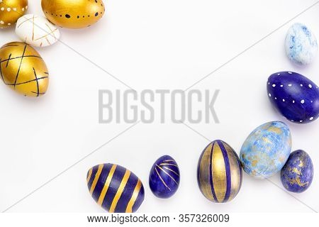 Happy Easter. Frame For Text Made Of Easter Eggs Trendy Colored Classic Blue, White And Golden On Wh
