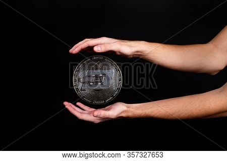 The Symbol Of The New Popular Cryptocurrency Dash With The Image Of Hands On Dark Background