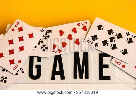 Game Night Text On Lightbox With Playing Cards On Yellow Background, Table Games, Board Games And Sc