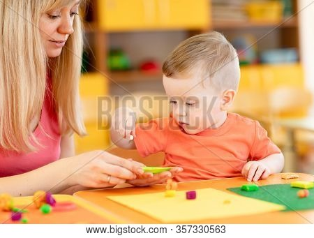Child Kid Boy And Mother Play Colorful Clay Toy At Nursery Or Kindergarten