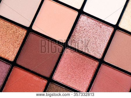 Make up palette set. Professional multicolor eyeshadow palette. Makeup. Professional multicolor eye shadow make-up palette background, close-up. Various Colorful bright eye shadows backdrop
