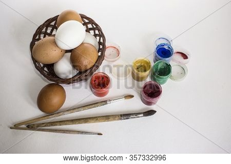 Kid Painting On Easter Eggs. Painting Is Play Therapy For Adhd Kids Attention Deficit Hyperactivity