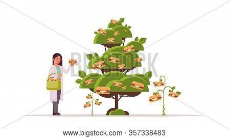 Female Scientist Picking Plant Based Vegetarian Burgers Beyond Meat From Tree Organic Natural Vegan