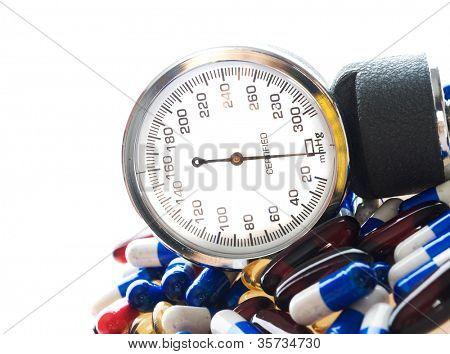 medical report. sphygmomanometer and pills