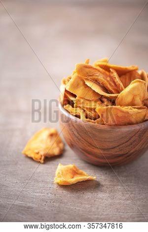 Dried Mango In Wooden Bowl On Wood Textured Background. Copy Space. Superfood, Vegan, Vegetarian Foo