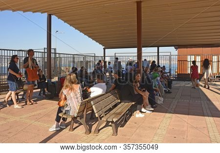 Kinaliada, Turkey - September 18th 2019. Tourists Wait Behind The Closed Gates To Board The Ferry Fr