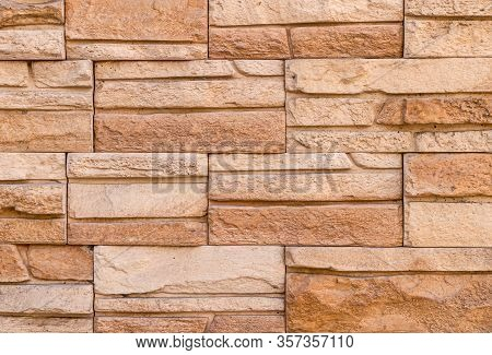 The Wall Is Made Of Decorative Facing Stone Such As Sandstone Or Slate. The Texture Of The Stone. St