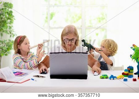 Mother Working From Home With Kids. Quarantine And Closed School During Coronavirus Outbreak.