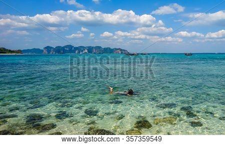 Krabi/thailand - 02.20.2019: Girl Snorkeling In Clear Blue Water, In Andaman Sea. Paradise Destinati