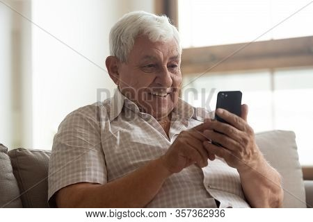 Smiling Older Man Holding Phone, Using Mobile Device Apps