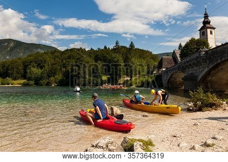 Bohinj, Slovenia - August, 03: People Kayaking In The Scenic Bohinj Lake On August 03, 2019