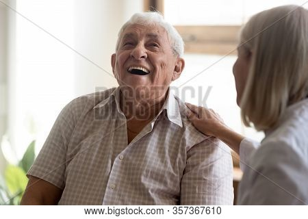 Excited Older Man Patient Laughing, Having Fun With Caregiver