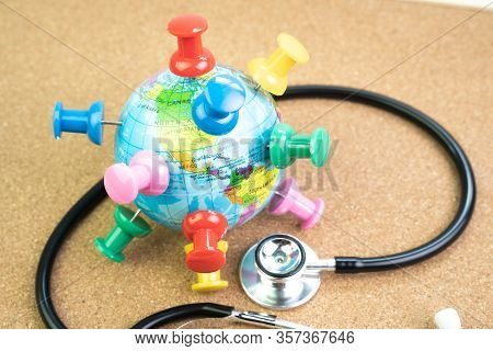 Covid-19 Coronavirus World Pandemic Concept, Big Thumbtacks Push Pins On Every Countries Of Planet E