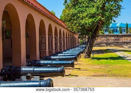 Kenya. Guns are on display in the fortress. Fort Jesus -  medieval fortification in Mombasa. The concept of historical, educational and photo tourism