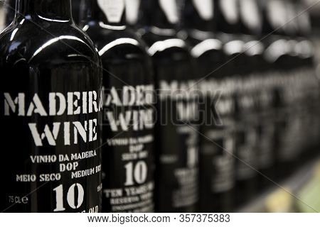 Funchal, Portugal - February 15, 2020: Detail Of 10 Year Old Medium Dry Madeira Wine Bottles In Func
